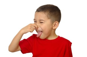 kid holding his nose from bad odor