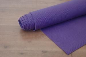 yoga-mat-on-wooden-floor