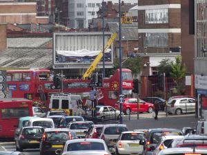Big_Brum_Buz_stuck_in_traffic_in_Digbeth_-_mobile_crane_(9428026291)